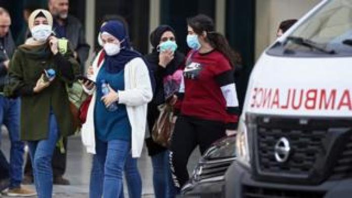 people outside Beirut hospital where the virus patient is being treated