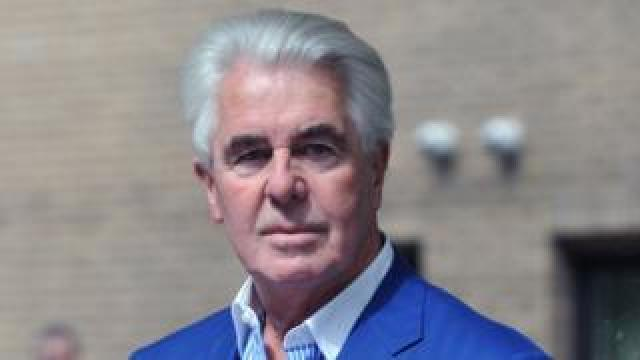 Max Clifford outside Southwark Crown Court in April 2014