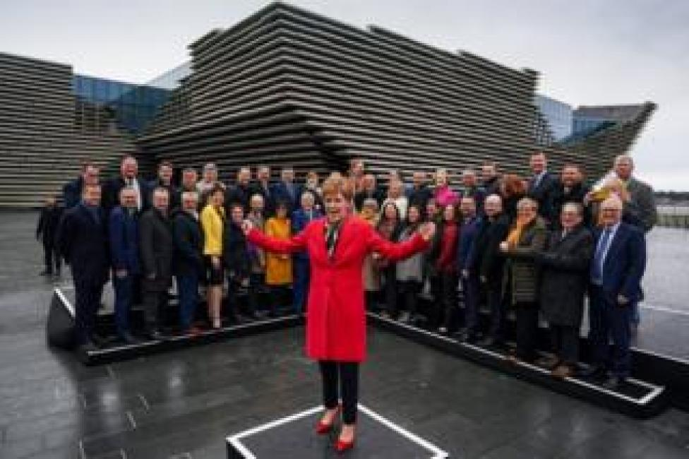 Nicola Sturgeon joins the SNP's newly elected MPs for a group photo outside the V&A Museum