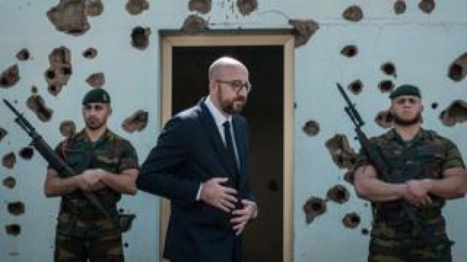Belgium's Prime Minister Charles Michel (C) walks after delivering a speech during a tribute ceremony for 10 Belgian UN peacekeepers killed during the 1994 Rwandan Genocide during the 25th commemoration of the genocide at Belgian Memorial Camp Kigali in Kigali, Rwanda - Monday 8 April 2019