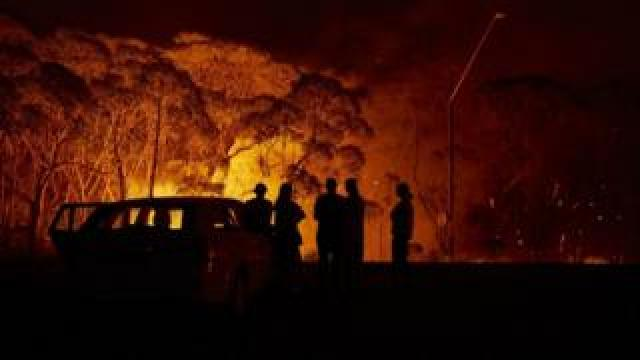 Residents look on at a fire in New South Wales