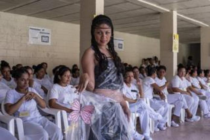 Prisoners present their fashion creations as part of the