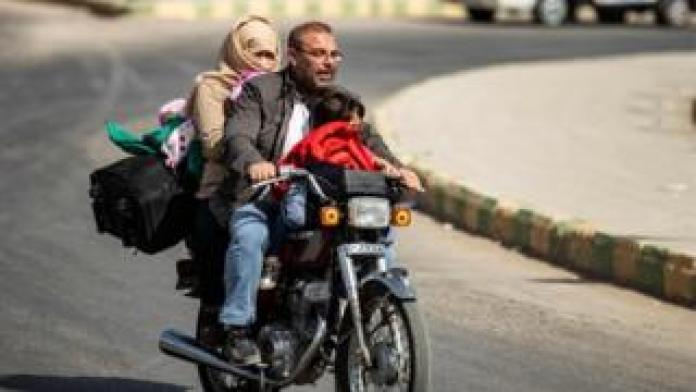 Syrians displaced by motorcycle fleeing Turkey