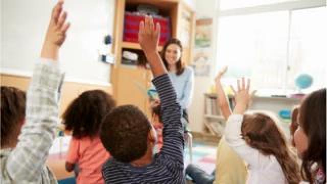 Teacher with primary pupils