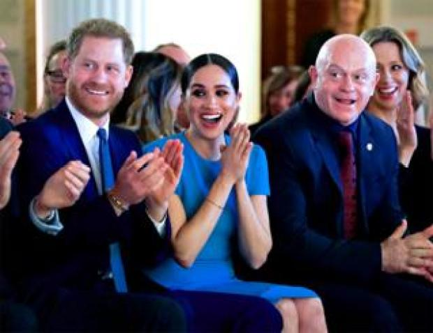 Harry, Meghan and Ross Kemp cheer to a wedding proposal