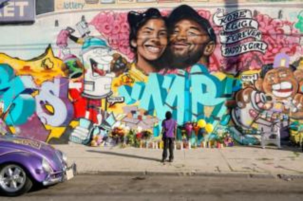 Fans gathered at a mural to pay respects to Kobe Bryant after a helicopter crash killed the retired basketball star, in Los Angeles, California, 28 January 2020.