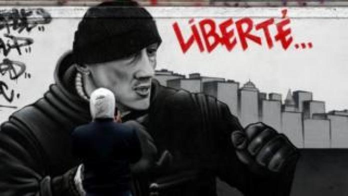 A mural of Dettinger throwing a punch