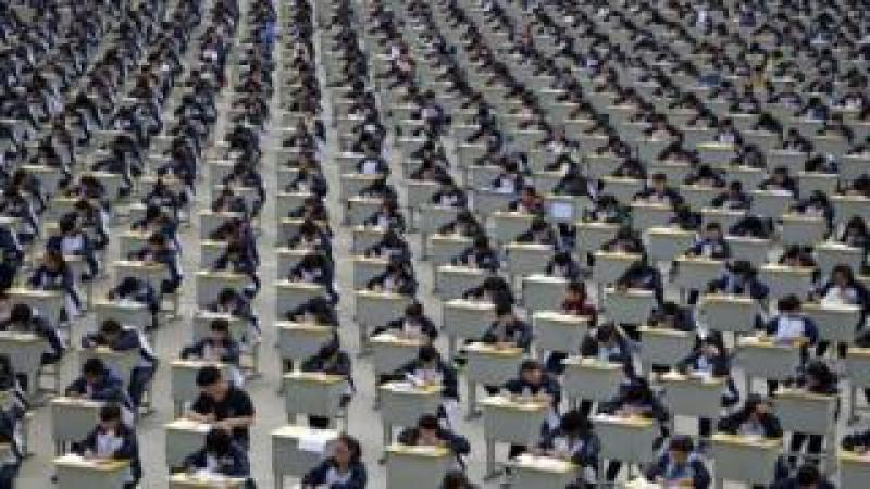 Students take an examination on an open-air playground at a high school in Yichuan, Shaanxi province 11 April 2015.