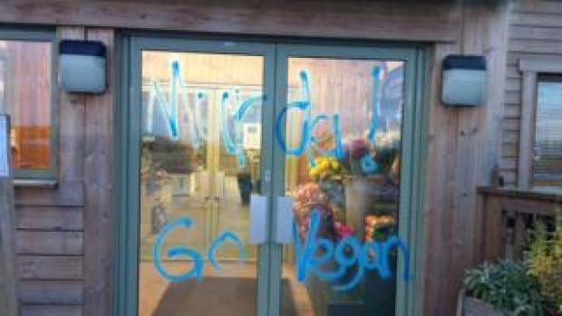Graffiti on the front door of Greendale Farm Shop