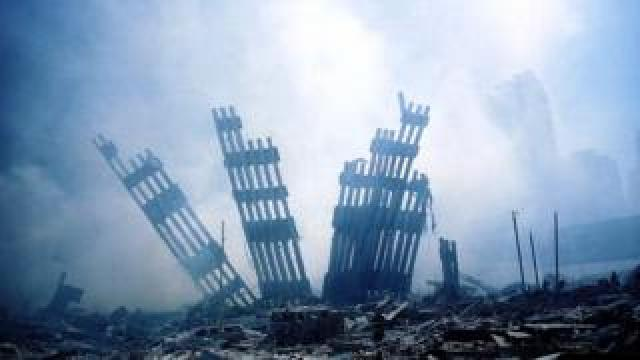 The rubble of the World Trade Center smoulders following a terrorist attack 11 September 2001 in New York