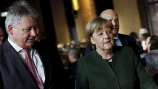 German Chancellor Angela Merkel, right, and the President of the German Federal Intelligence Agency (BND) Bruno Kahl at a ceremony on 28 Nov