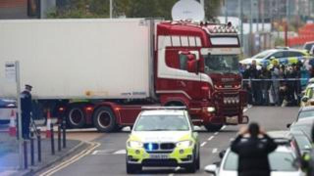Lorry container being moved under police escort