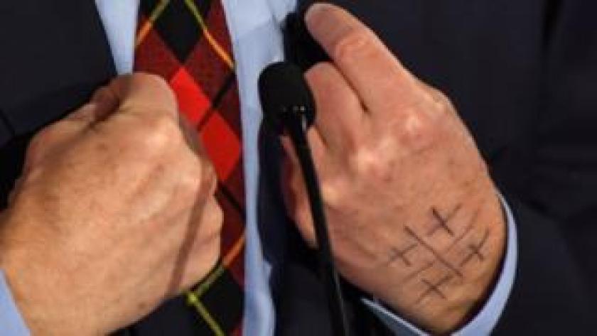 impeach Symbol on Tom Steyer's hands