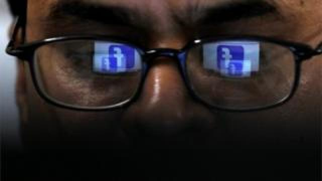 Man looking at Facebook