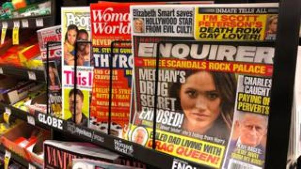 Newstand with National Enquirer closest to camera