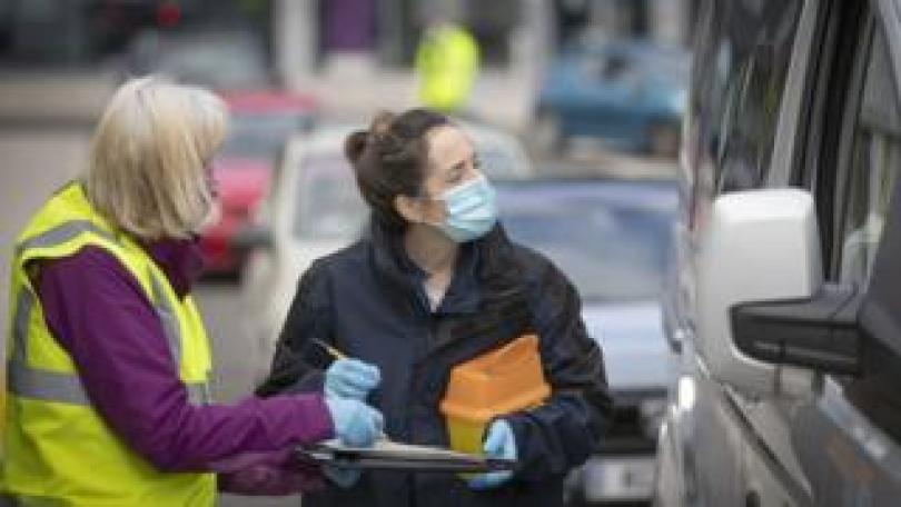 A nurse and a volunteer at a drive through clinic in Edinburgh on 26 September