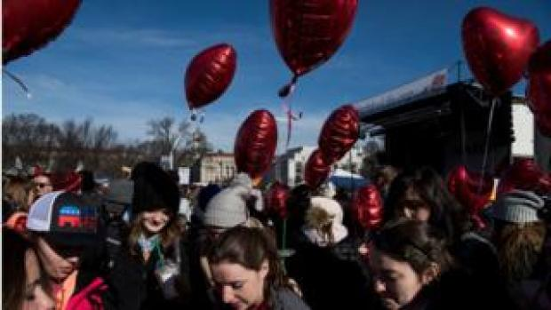 A group of 10th-12th grade students from Holy Spirit Church in Virginia, Minnesota hold heart balloons to show support for the 'Heartbeat Bill' during the March for Life, the world's largest annual pro-life demonstration, in Washington, DC on January 19, 2018.