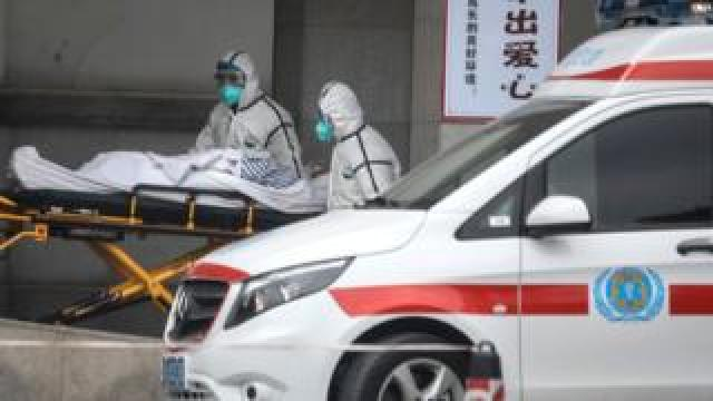 Medical staff transfer patients to Jin Yintan hospital on January 17, 2020 in Wuhan, Hubei, China.