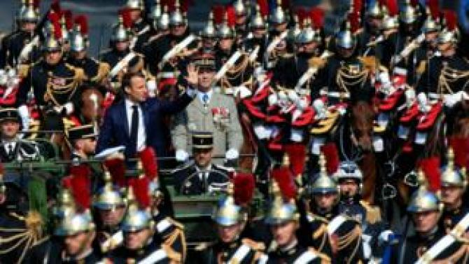 President Macron rides with the French army chief of staff