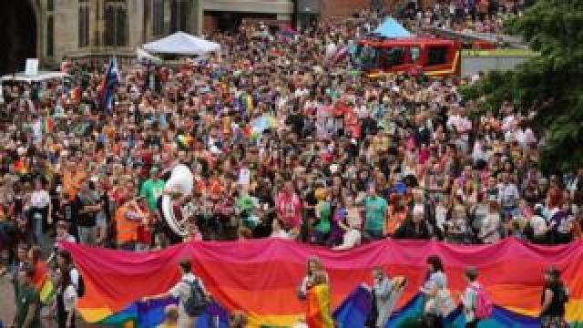 People wait for Norwich Pride march to start