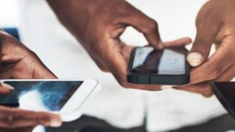 Hands holding smartphones