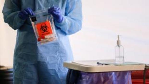 A nurse conducts a coronavirus test in Seattle