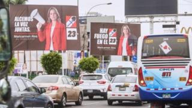 A general view of traffic at a street with electoral posters of Maricarmen Alva, a candidate for Congress from the Popular Action party, in Lima, 22 January 2020