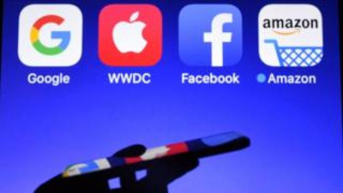 Google, Apple, Facebook and Amazon app logos on screen