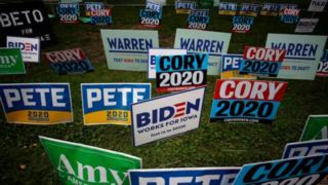 Signs for many of the Democratic Party presidential candidates at the Polk County Steak Fry