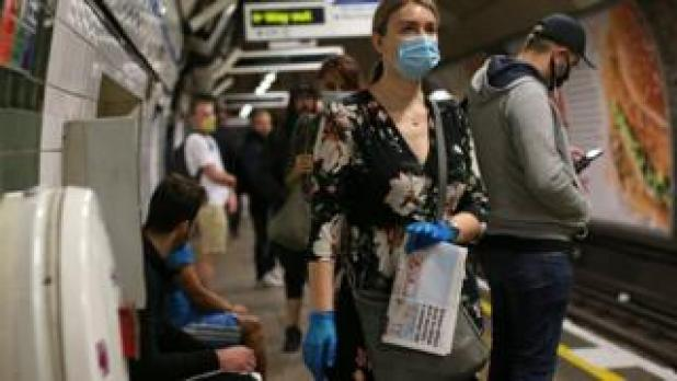 Travelers in face masks