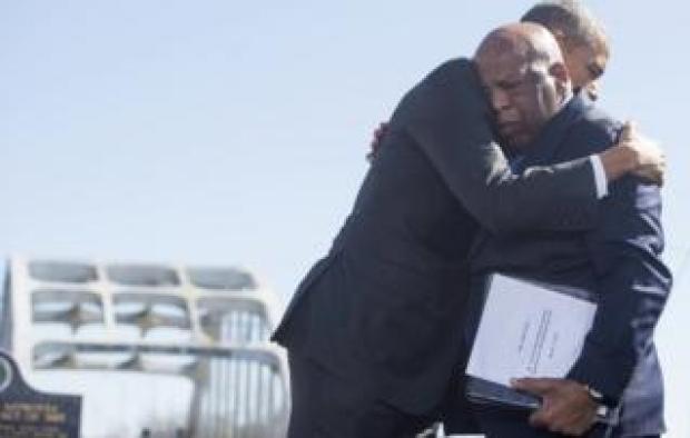 Barack Obama (L) hugs US Representative John Lewis near the Edmund Pettus Bridge in Selma