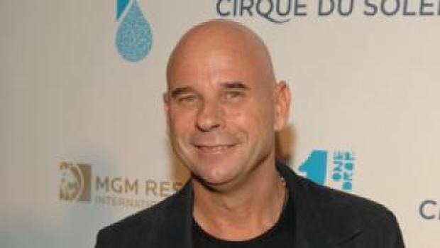 Guy Laliberte smiles at a Cirque du Soleil event