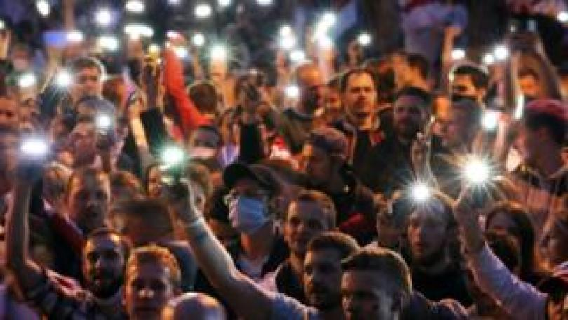 Belarus opposition activists light up their mobile phones during a peaceful protest rally against the results of the presidential elections, in Minsk, Belarus, 25 August 2020.