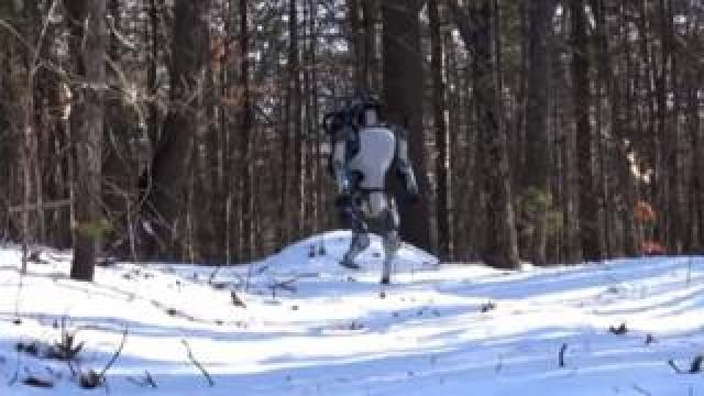 Atlas robot walking in the snow.