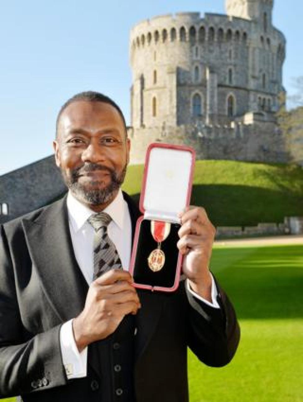 Sir Lenny Henry after receiving a Knighthood from Queen Elizabeth II during an Investiture ceremony at Windsor Castle on December 4, 2015 in Windsor, England