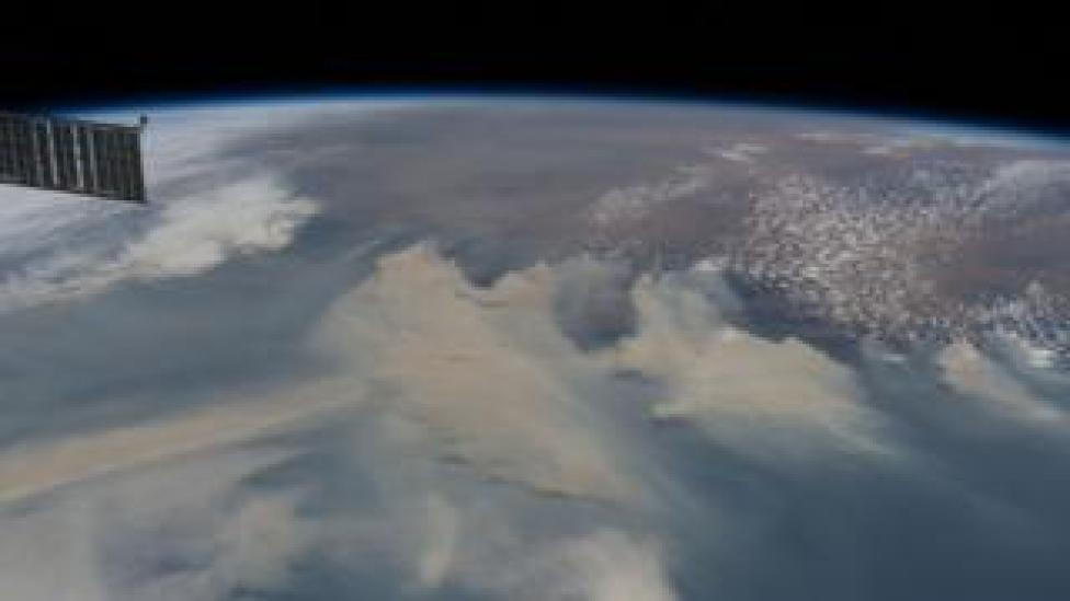 Smoke from forest fires covers the southeast coast of Australia on January 8, 2020 while the International Space Station orbited 269 miles above the Tasmanian Sea.