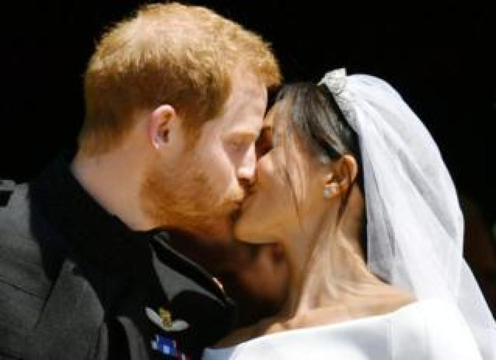 Prince Harry and Meghan Markle kiss on the steps of St George's Chapel in Windsor Castle