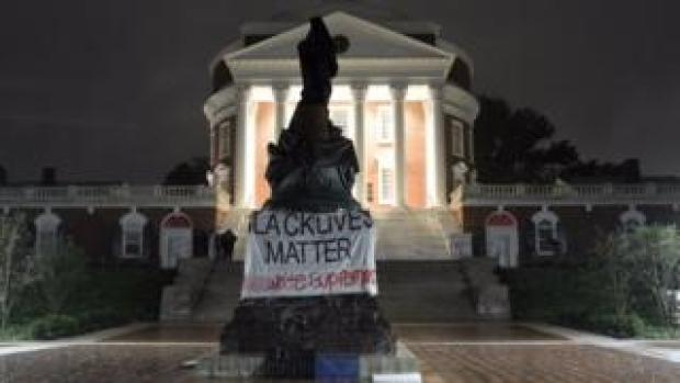Picture shows the statue of Thomas Jefferson covered in Charlottesville