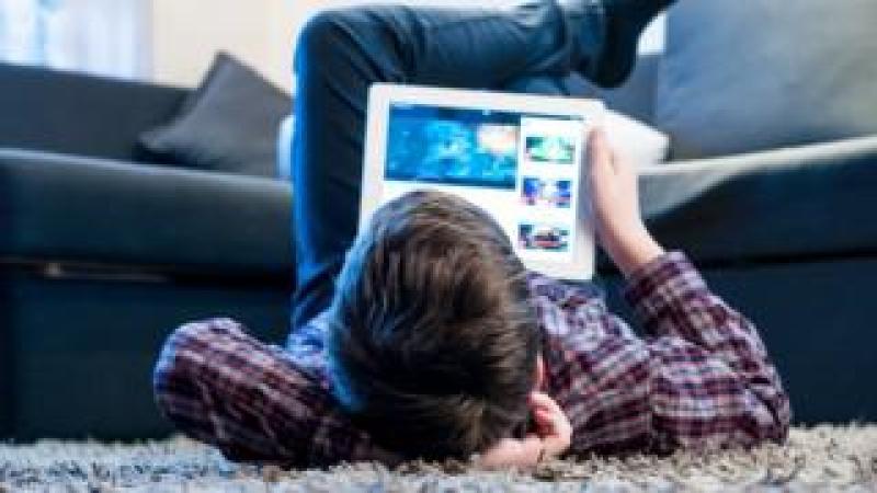 Teenager on an i-Pad