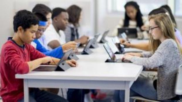 Schoolchildren using computers