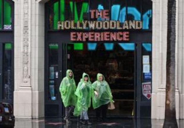 Rainsoaked visitors to the Hollywoodland experience
