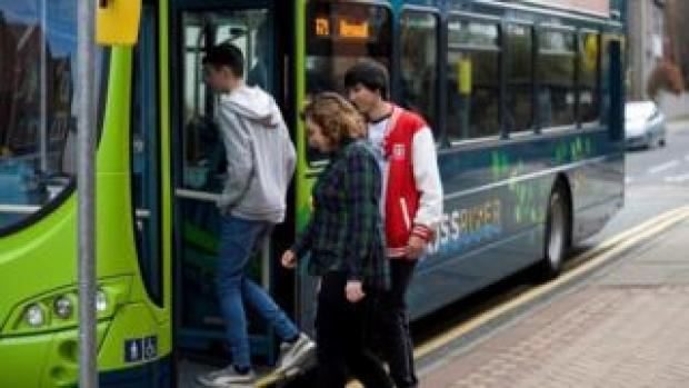 Young people boarding a bus