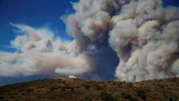 Smoke from a wildfire is seen in Calabasas, California
