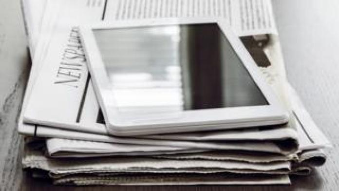 Newspapers and an tablet