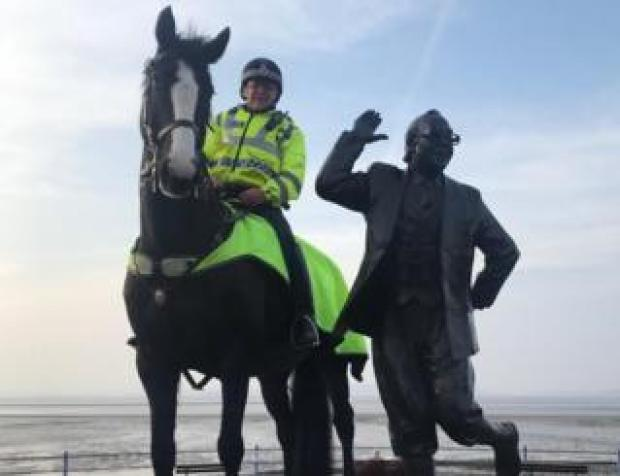 Morecambe police horse with Eric Morecambe statue