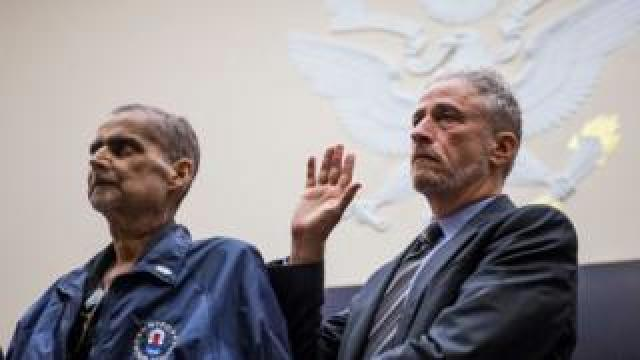 Retired New York Police Department detective and 9/11 responder Luis Alvarez, left, and Former Daily Show Host Jon Stewart, right are sworn in before testifying during a House Judiciary Committee hearing on reauthorization of the September 11th Victim Compensation Fund on Capitol Hill on June 11, 2019 in Washington, DC