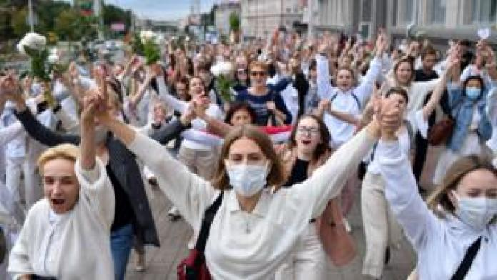 Women dressed in white clothes protest against police violence during recent rallies