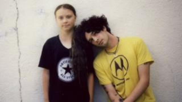 Greta and Matty Healy stood together