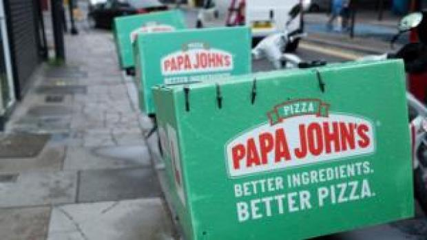 Papa John's delivery boxes strapped to motorcycles in London