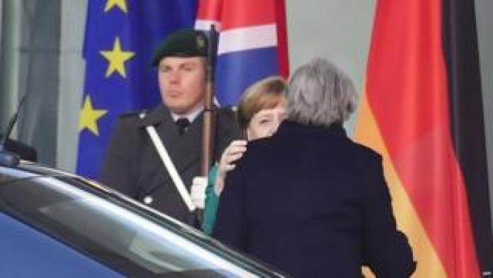 Angela Merkel greets Theresa May as she arrives at the Chancellery in Berlin